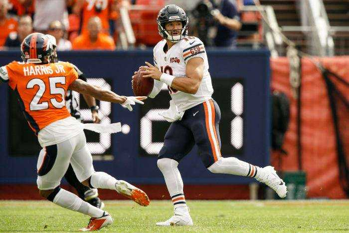 Chicago Bears quarterback Mitchell Trubisky (10) looks to pass as Denver Broncos cornerback Chris Harris Jr. (25) defends in the first quarter at Empower Field in Mile High.